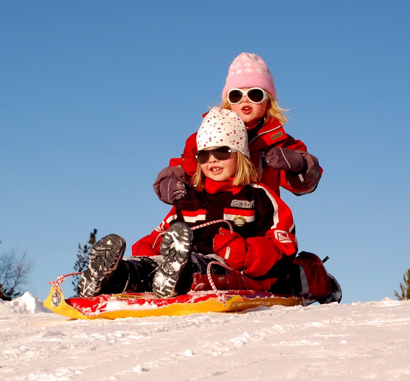 sweden-children-girls-sled-70448.jpeg